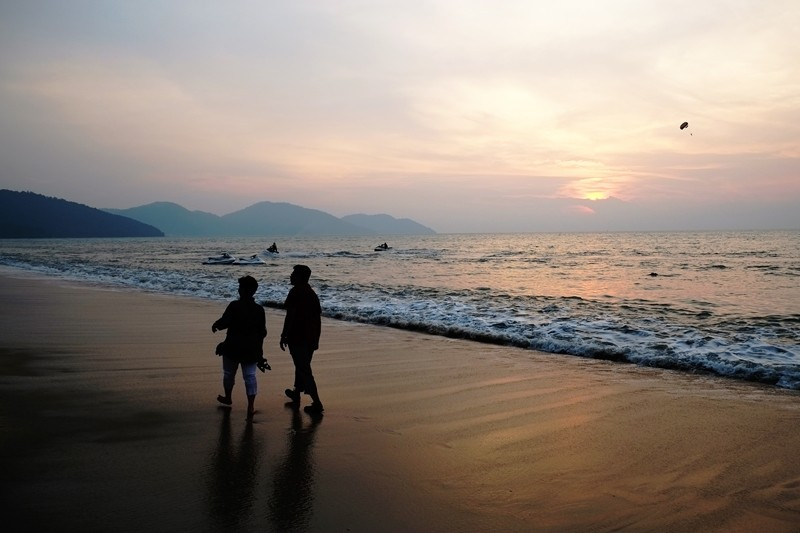 Sunset walk on Batu Ferringhi Beach, Penang